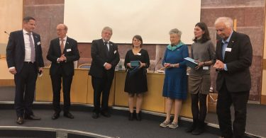 Julijana Gjorgjieva (middle) at the awarding ceremony (photo by Simone Bell, EMBL)